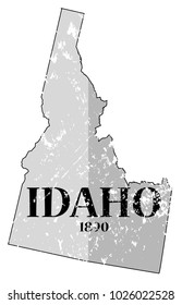 A grunged Idaho state outline with the date of statehood isolated on a white background