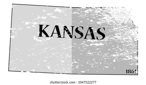A grunged Kansas state outline with the date of statehood isolated on a white background