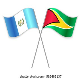 Guatemalan and Guyanese crossed flags. Guatemala combined with Guyana isolated on white. Language learning, international business or travel concept.