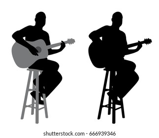 Guitar player sitting on a bar stool