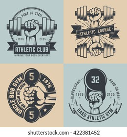 Gym logo in vintage style. Hand with dumbbell, with kettle bell - hard athletic logos. Workout emblem.