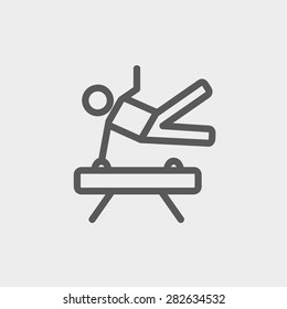 Gymnast on pommel horse icon thin line for web and mobile, modern minimalistic flat design. Vector dark grey icon on light grey background.