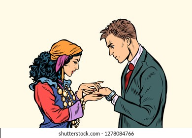 a Gypsy telling fortunes by the hand to the businessman. A fortune-teller palmist. Pop art retro vector illustration kitsch vintage