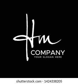 H M Initial Letter handwriting logo vector. Hand lettering for designs