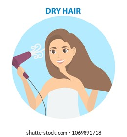 Hair care. Woman drying hair with blowdryer.