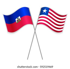 Haitian and Liberian crossed flags. Haiti combined with Liberia isolated on white. Language learning, international business or travel concept.