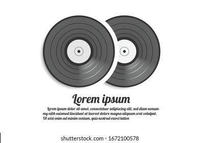 half of a black and white vinyl record in a yellow paper case.