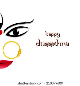 Half face of smiling Goddess Durga on simple white background wearing jwellery.