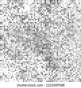 Halftone texture is black and white. The pattern of the ink points are randomly arranged. Vector monochrome background. Abstract the surface of chaos