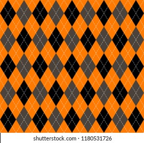 Halloween Argyle plaid. Scottish pattern in orange, black, gray and white  rhombuses. Scottish cage. Traditional Scottish background of diamonds . Seamless fabric texture. Vector illustration