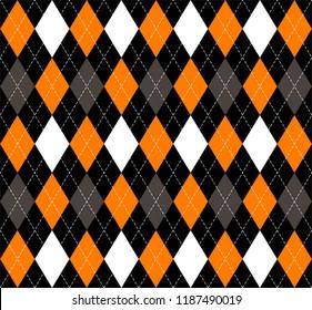 Halloween Argyle plaid. Scottish pattern in orange, black, gray and white  rhombuses. Scottish cage. Traditional Scottish background of diamonds . Seamless fabric texture. Vector illustration