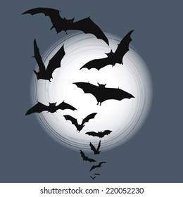 Halloween background - flying bats in full moon