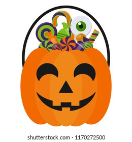Halloween Candy Bucket and Candies - Jack O Lantern Halloween candy bucket with handle holding many colorful Halloween candies isolated on white background