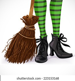 Halloween closeup witch legs in boots and with broomstick isolated on a white background