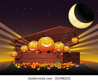Halloween Coffin of Goodies-Stash of trick or treat candies against midnight sky