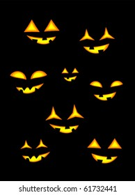 Halloween jack o' lanterns in darkness. Glowing eyes and mouth
