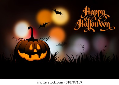 Halloween night blurred background with pumpkin and calligraphy inscription Happy Halloween. Vector illustration.