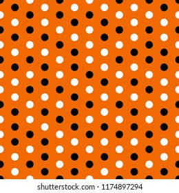 Halloween Polka Dots Seamless Pattern - Black and white dots on orange background