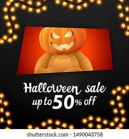 Halloween sale, square black discount banner with a hole that looks at us Teddy bear with Jack pumpkin head. Discount banner with up to 50% off