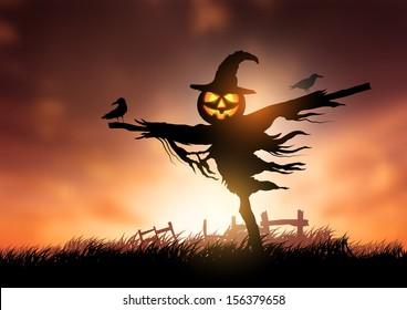 A halloween Scarecrow with a Jack O Lantern head.