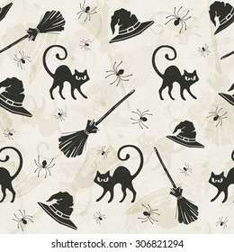 Halloween seamless pattern with cats, brooms and witch hats.