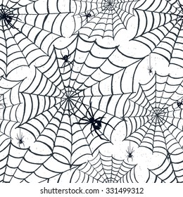 Halloween seamless pattern with hand drawn textured vector illustrations of spiders on webs.