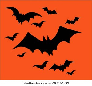 Halloween, set of bats  flying on a orange background