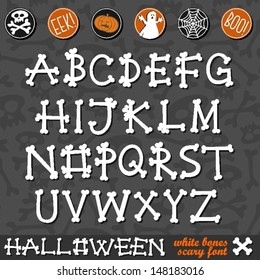 halloween white bones scary font latin alphabet and halloween related buttons on dark background education set