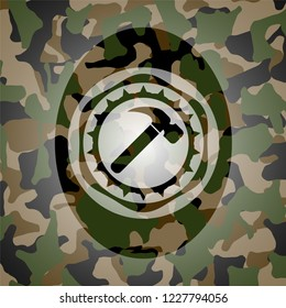 hammer icon on camouflaged pattern