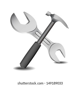 hammer and spanner on a white