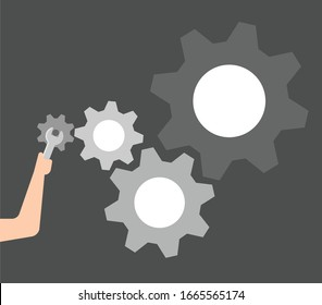 The hand is about to separate the mechanism.
