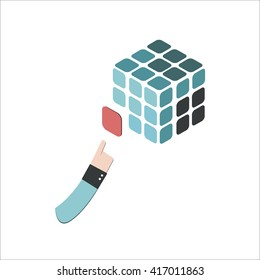 Hand adds a detail to rubik's cube illustration