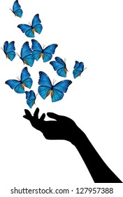 Hand with blue butterflies flying