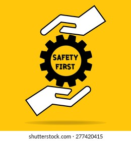 hand of businessman hold safety first heart in cog gear importance of safety on yellow background: management business concept