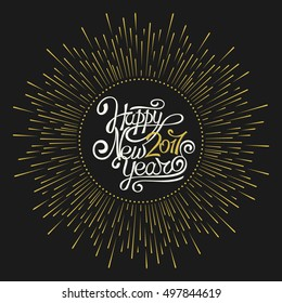 Hand calligraphy. The inscription Happy New Year 2017 on a dark background. The explosion fireworks. Template for greeting cards, banners, invitations.