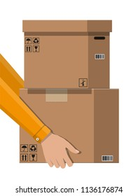 Hand of courier with postal cardboard box. Carton delivery packaging closed box with fragile signs. Vector illustration in flat style