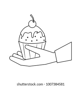 Hand with cupcake