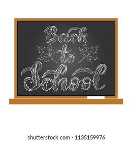 "Hand draw chalk lettering: ""Back to school"" on the school board.Vector illustration."