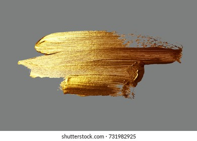 hand drawing gold brush stroke paint spot on a gray background, handmade vector illustration