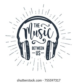 "Hand drawn 90s themed badge with headphones vector illustration and ""The music between us"" inspirational lettering."