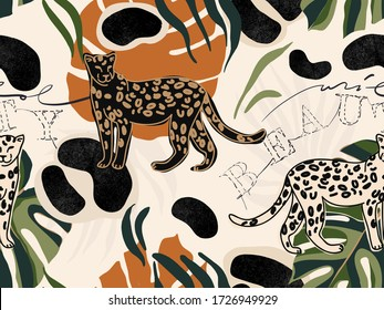 """Hand drawn abstract jungle pattern with leopards. Creative collage contemporary seamless pattern. Natural colors. Fashionable template for design. Text """"WILD BEAUTY""""."""