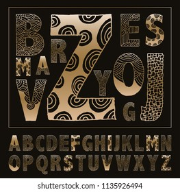 hand drawn alphabet decorated with graphic doodles in gold and black