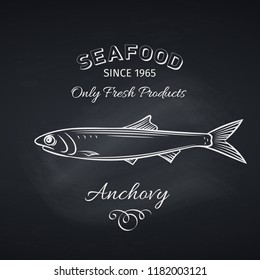 Hand drawn anchovy fish on chalkboard. Seafood icon menu restaurant design. Engraving style. Vector illustration.