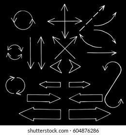 Hand drawn arrows set on blackboard. Sketch design symbols. Vector doodle illustration.