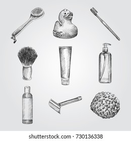 Hand Drawn Bathroom accessories Sketches Set. Collection Of Sponge, Toothbrush, Toothpaste, bath brush, Bathroom Duck, Liquid Soap, Shampoo, Razor, Shaving Brush Sketches isolated on white background
