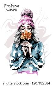 Hand drawn beautiful young woman holding autumn leaf. Stylish elegant girl. Fashion woman portrait. Sketch.