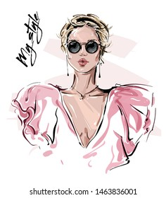 Hand drawn beautiful young woman in sunglasses. Stylish girl. Fashion woman look. Sketch. Vector illustration.