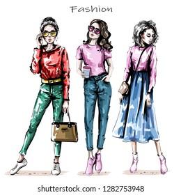 Hand drawn beautiful young women set. Stylish girls. Fashion women looks. Sketch. Vector illustration.