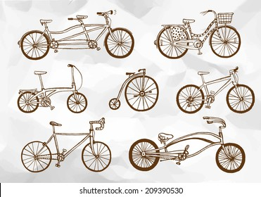 Hand drawn bicycle types set on paper background