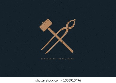 Hand drawn blacksmith tools on a dark background. Crossed hammer and tongs. Old logo, symbol in retro style. Monochrome style. Vector illustration.
